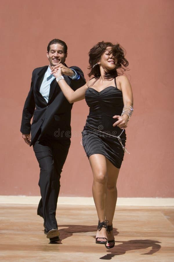 Happy couple running royalty free stock photos