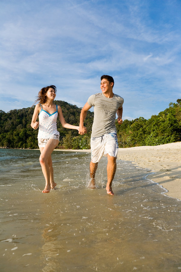 Download Happy Couple Running Along The Stock Photo - Image: 4569212