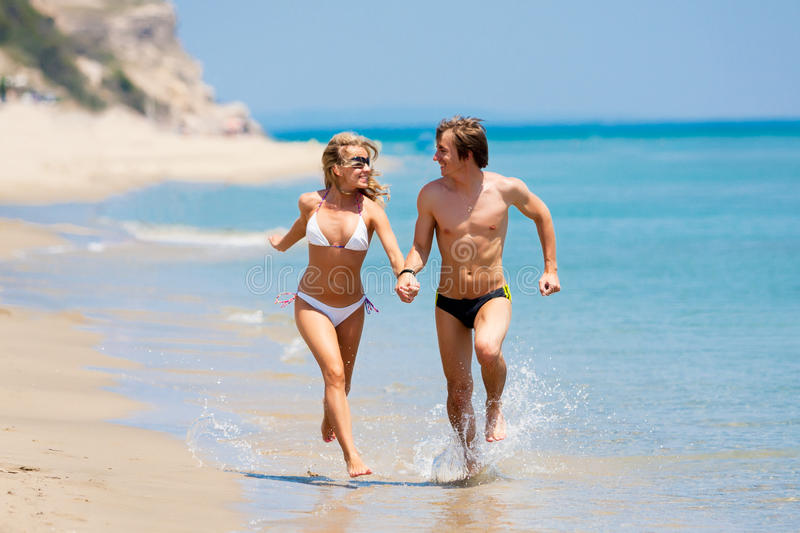 Download Happy Couple Running On Beach Stock Image - Image: 15616913