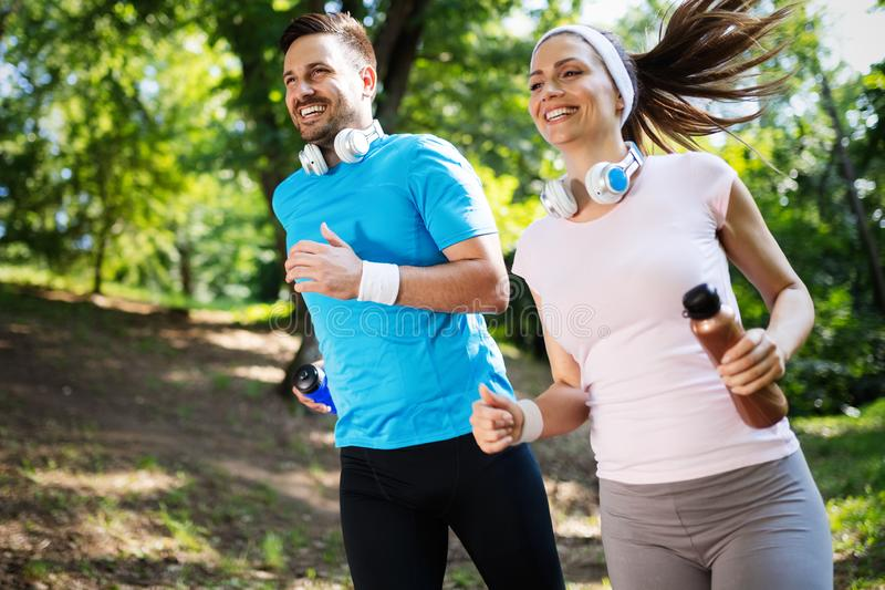 Happy couple running and exercising together outdoor royalty free stock photos