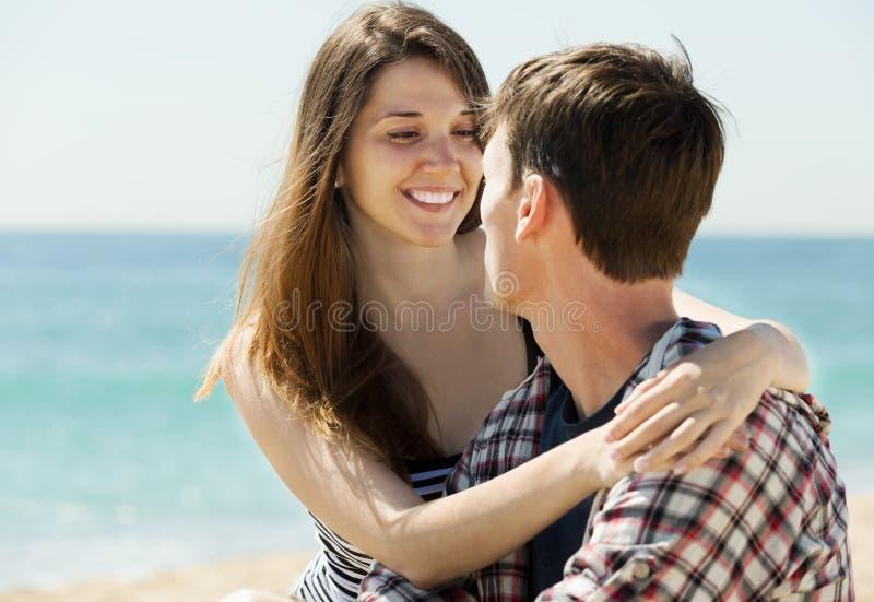 Happy couple on sandy beach. Happy couple having romantic date on sandy beach at sunny day stock photos