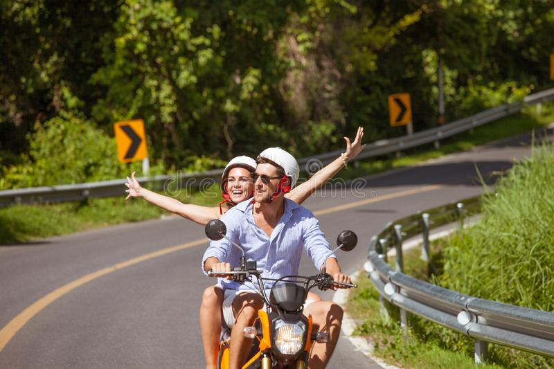 Happy couple on a scooter stock images