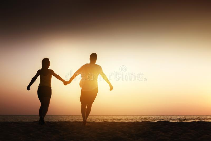Happy couple sea beach run stock photo