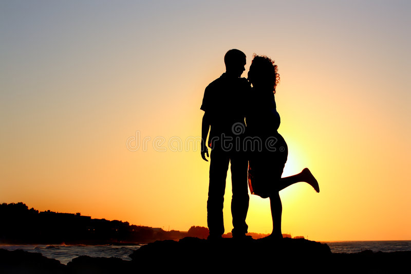 Download Happy Couple By The Sea Silhouette Stock Photo - Image: 6543692