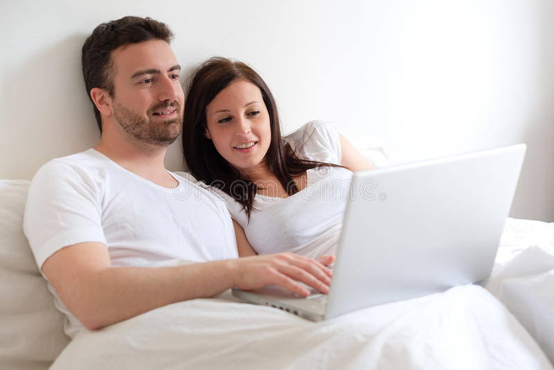 Happy couple searching for consumer advice in internet stock image