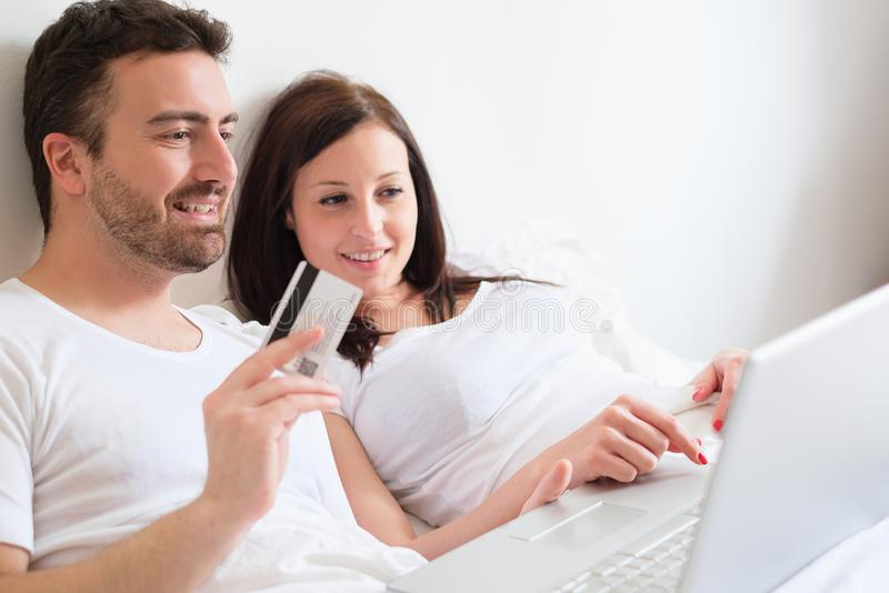 Happy couple searching for consumer advice in internet stock photo