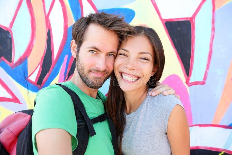 Happy couple selfie portrait, Berlin Wall, Germany. Happy couple selfie selfportrait in front of Berlin Wall, Berlin, Germany. Beautiful young interracial couple stock photos