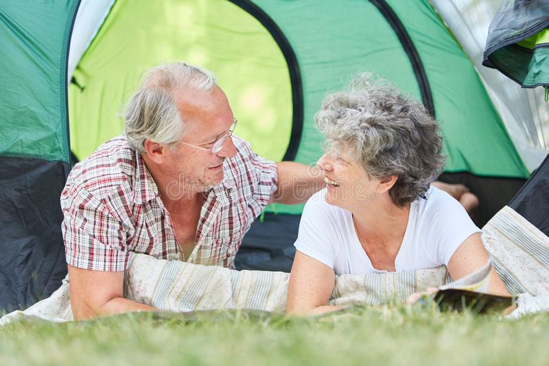 Happy couple seniors camping stock photos