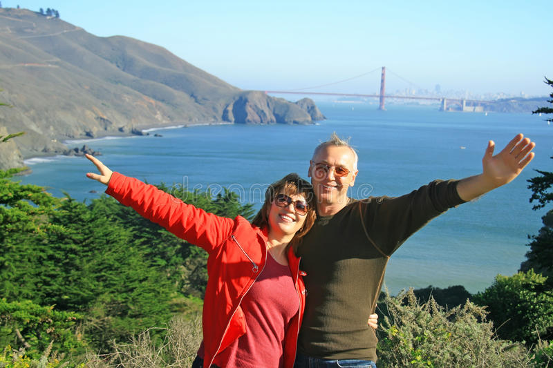 A happy couple in SF, Golden Gate Bridge royalty free stock photo