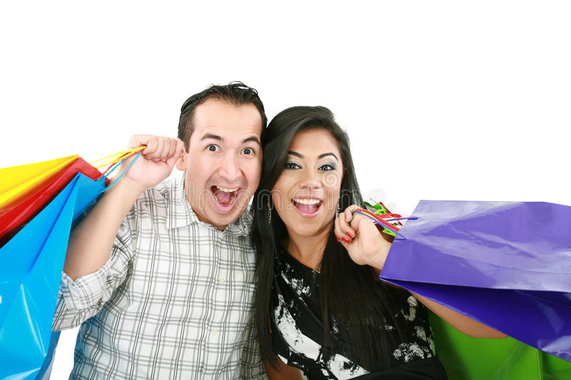 Happy couple with shopping bags stock photo