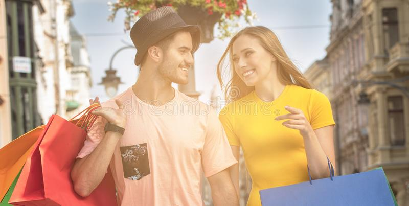 Happy couple with shopping bags. royalty free stock photos