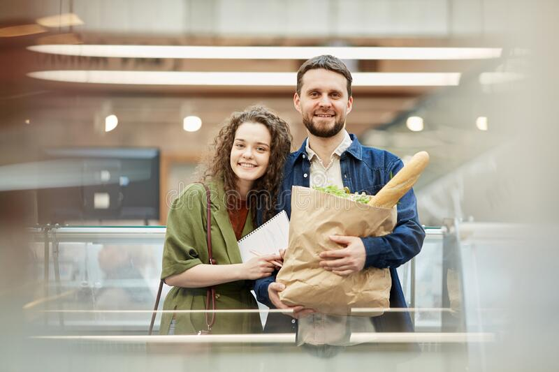 Happy Couple Shopping in Supermarket stock photography