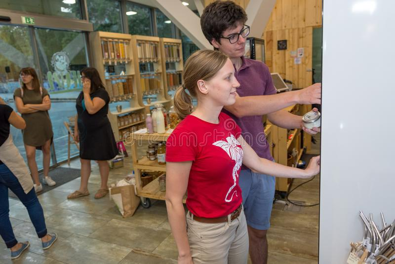 Happy couple shopping in a zero waste store. stock photos