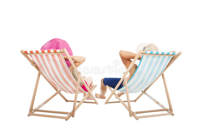 Happy Couple sitting on beach chairs stock photos