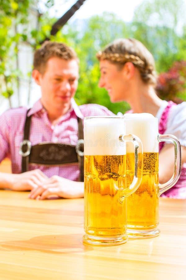 Download Happy Couple In Beer Garden Drinking Beer Royalty Free Stock Images - Image: 30193859