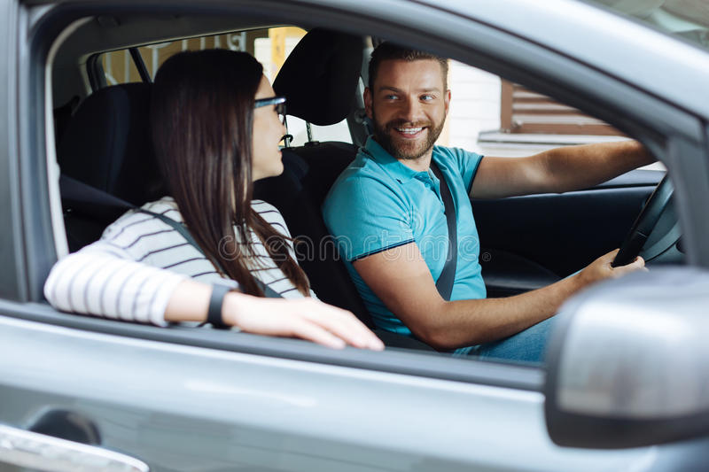 Happy couple sitting in their new car stock image
