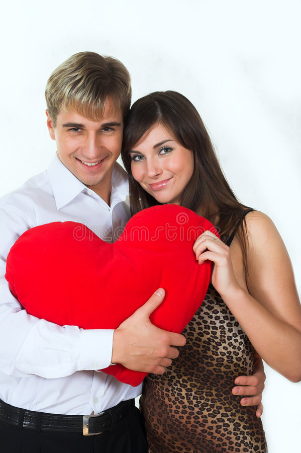Happy couple smiling over a white background stock image