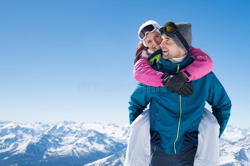 Happy couple in snow royalty free stock photo