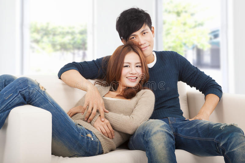 Happy Couple in sofa at home royalty free stock image