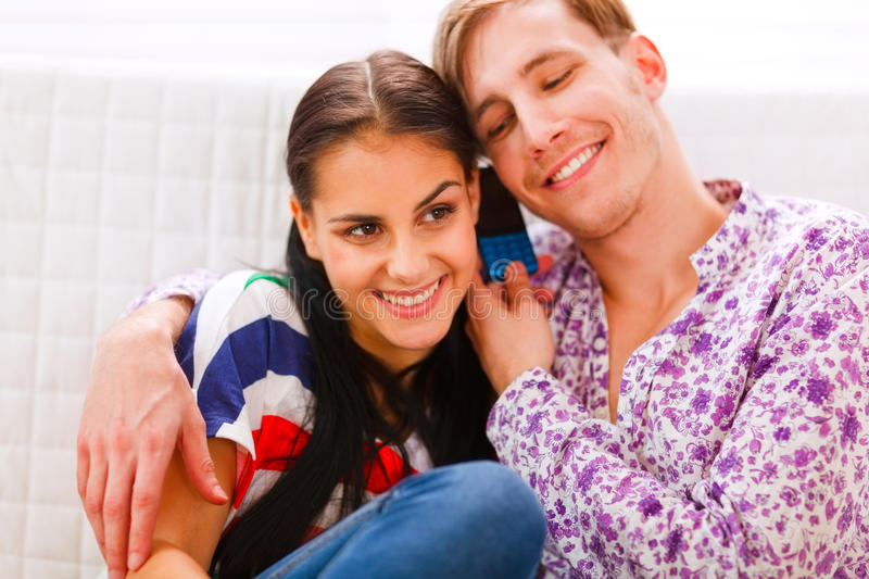 Happy Couple Speaking Together On Cell Phone Stock Image
