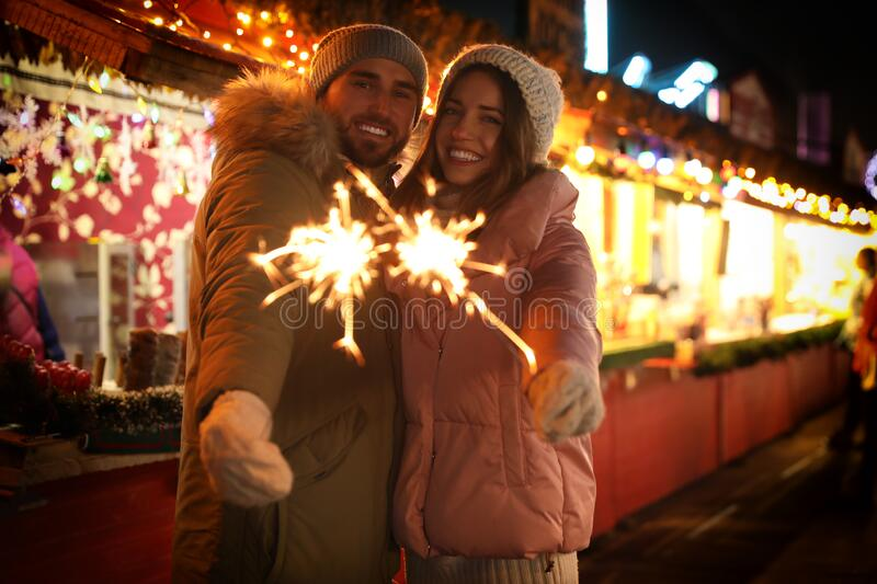 Couple spending time at Christmas fair royalty free stock photography