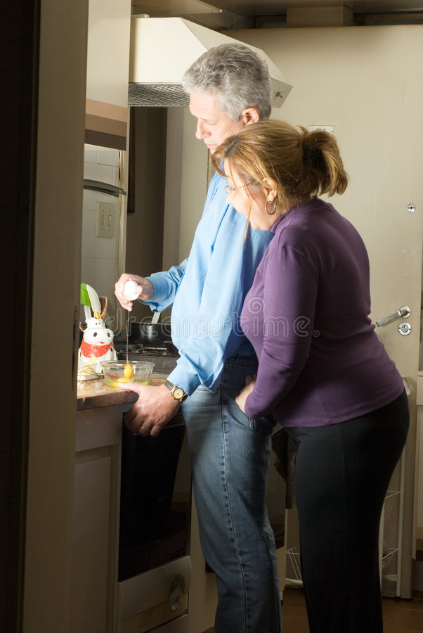 Download Happy Couple Spending Time Cooking - Vertical Stock Image - Image: 5580001