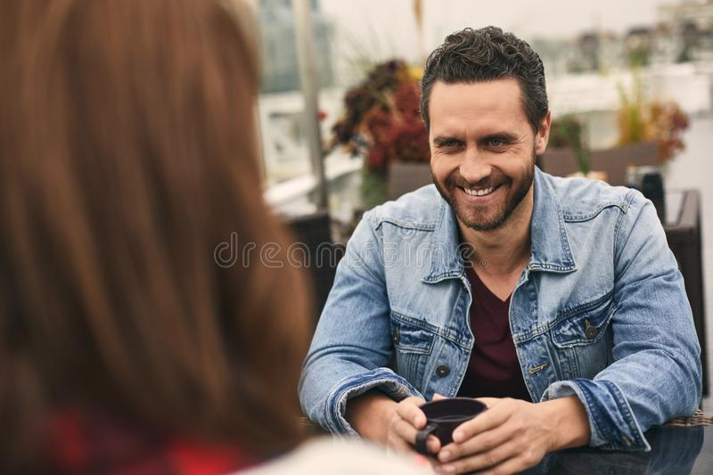 Happy couple is spending time in terrace stock photography