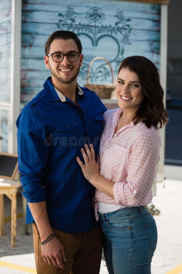 Happy couple standing at cafe royalty free stock images