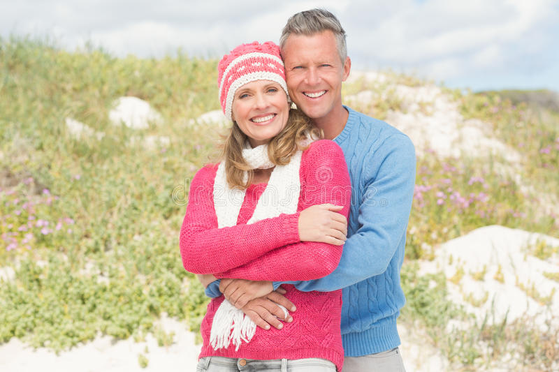 Happy couple standing and holding each other royalty free stock image