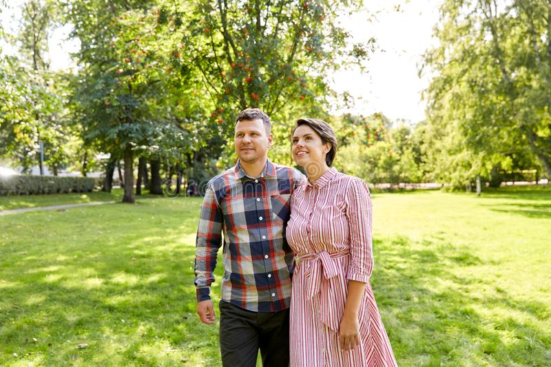 Happy couple in summer park stock images