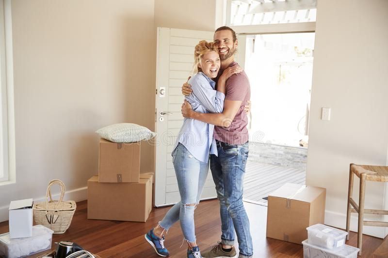 Happy Couple Surrounded By Boxes In New Home On Moving Day royalty free stock photos