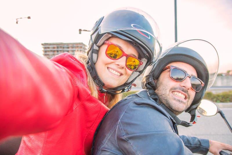 Happy couple taking selfie on moped. An Happy couple taking selfie on moped royalty free stock photography