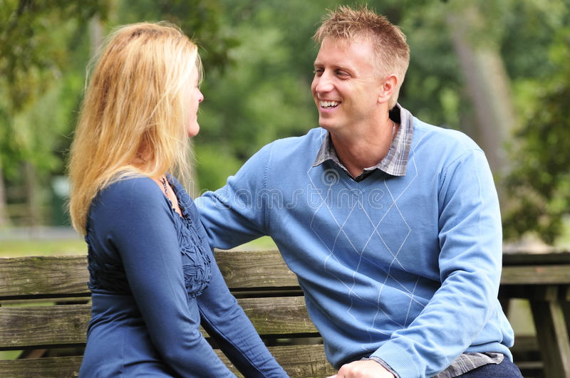 Happy couple talking stock images