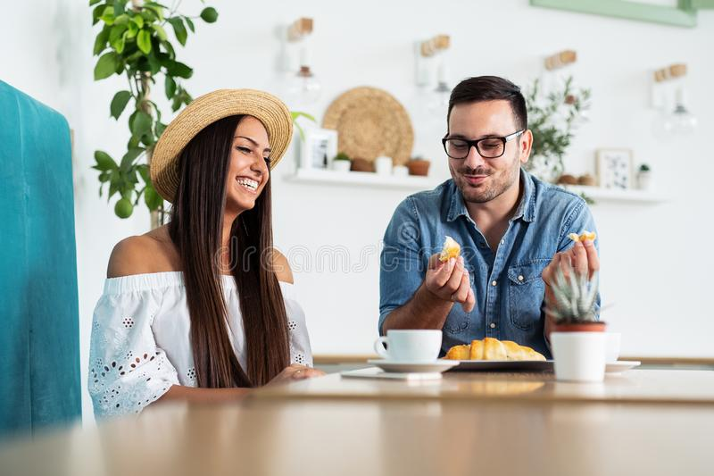Happy couple talking at cafe, eating lunch. stock photo