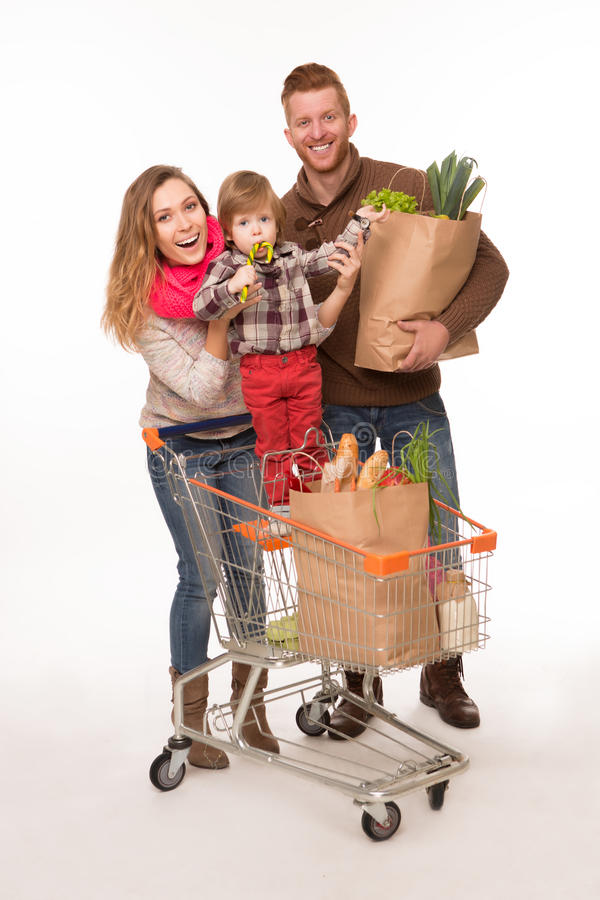 Happy couple with their baby after shopping stock image