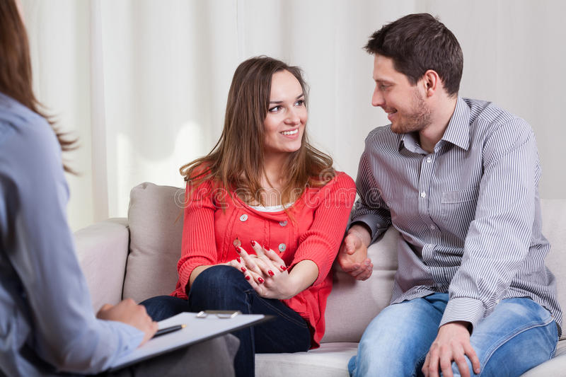 Happy couple after therapy. Beauty couple solved their problems on psychotherapy