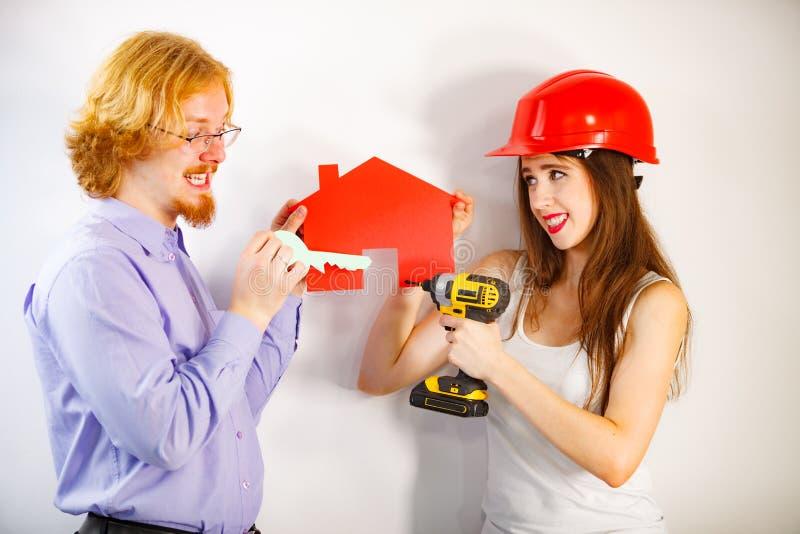 Couple doing house model renovation stock photos