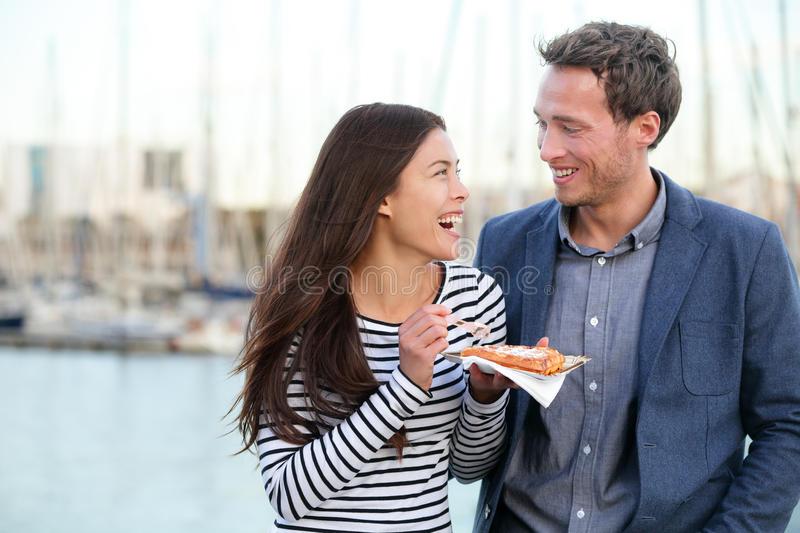 Happy couple tourists eating waffles in Barcelona stock photo