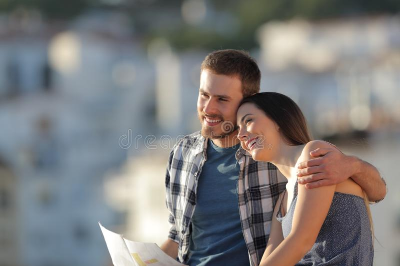 Happy couple of tourists in love contemplating views royalty free stock photo