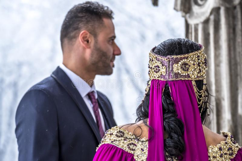 Happy couple in traditional turkish wedding dress during their wedding stock image
