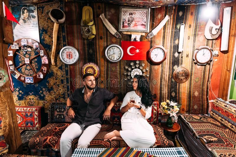 Happy couple in Turkey. Man and woman in the Eastern country. A couple in love travels. Happy couple having tea. Turkish hospitali stock images