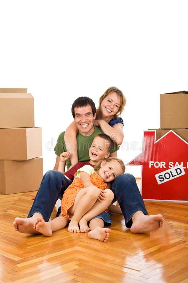 Happy Couple With Two Kids In Their New Home Royalty Free Stock Photos
