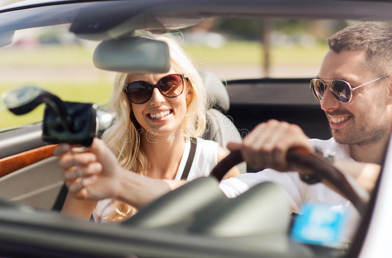 Happy couple usin gps navigation system in car royalty free stock image
