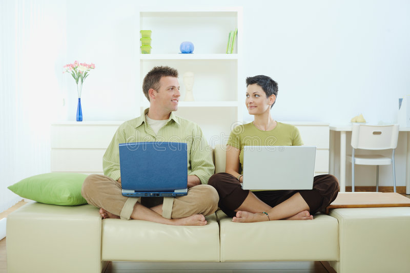 Happy couple using computer royalty free stock photo