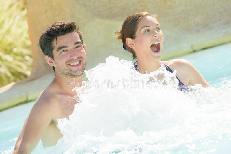 Happy couple using jacuzzi royalty free stock photography