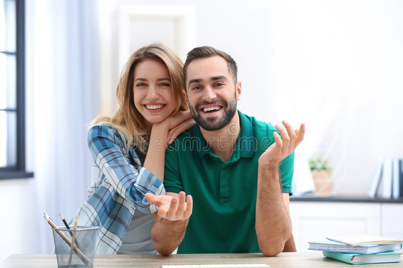 Happy couple using video chat for conversation. Indoors stock photos
