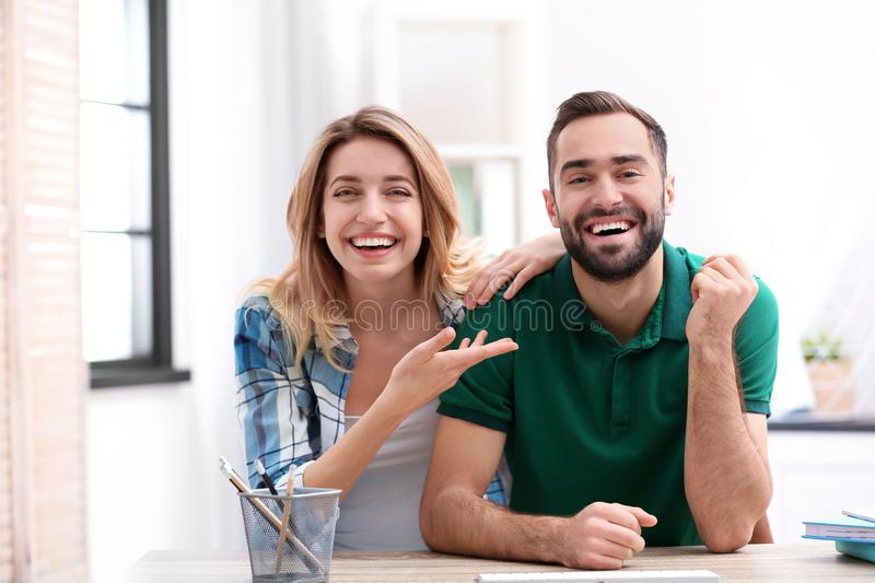 Happy couple using video chat for conversation. Indoors royalty free stock image