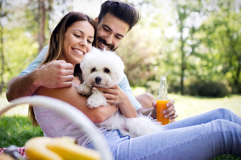 Happy couple on vacation. Lovers enjoy each other in the park, picnic. Happy couple on vacation. Lovers enjoy each other in the park stock photo