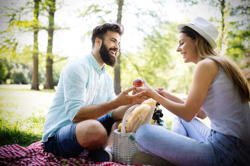 Happy couple on vacation. Lovers enjoy each other in the park, picnic. Happy couple on vacation. Lovers enjoy each other in the park stock photos