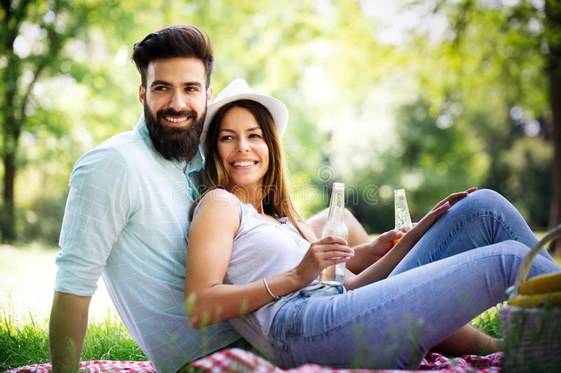 Happy couple on vacation. Lovers enjoy each other in the park, picnic. Happy couple on vacation. Lovers enjoy each other in the park stock image
